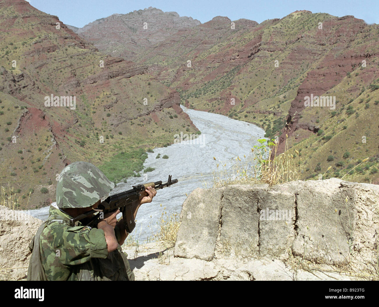 Serviceman of the 149th Motorized Rifle Regiment of the 209th Motorized Rifle Division at the observation post located - Stock Image