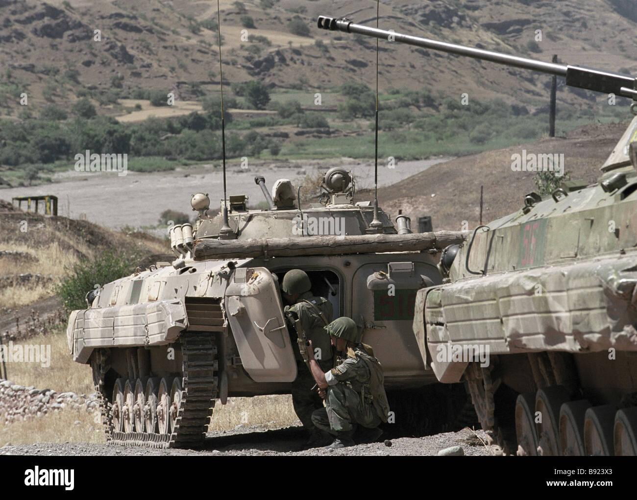 Motorized rifle regiment of 201 st motorized rifle division near Pyandzh River - Stock Image