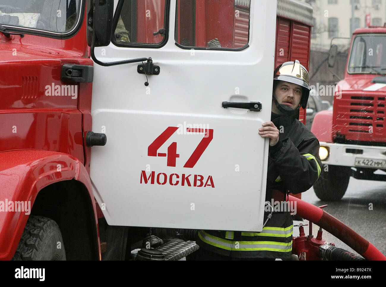 Fire brigade arriving to extinguish the fire that has swept the building of the Peter the Great military academy - Stock Image