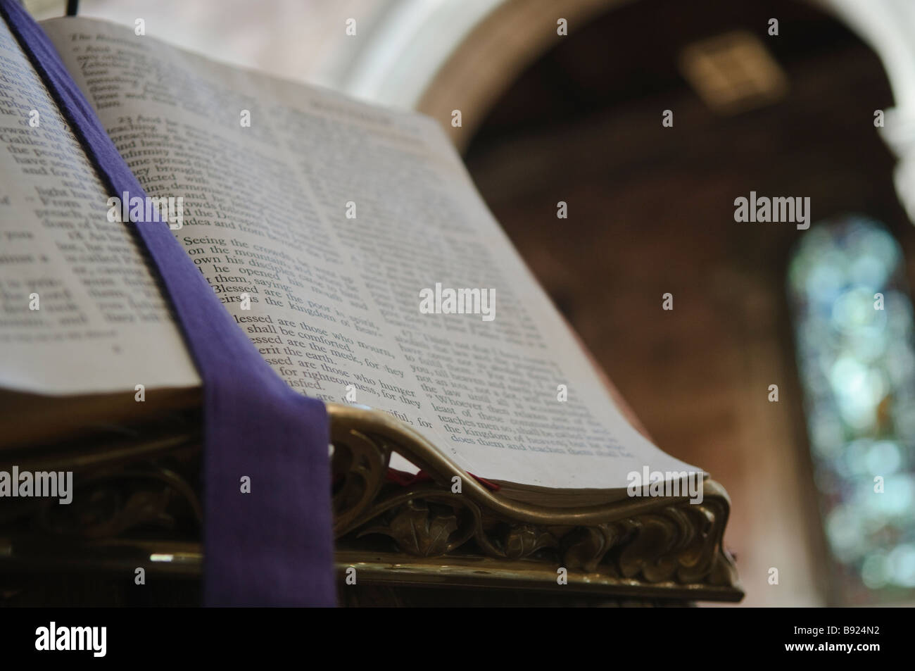 Bible on pulpitin a cathedral, open at Matthew Chapter 5. Stock Photo