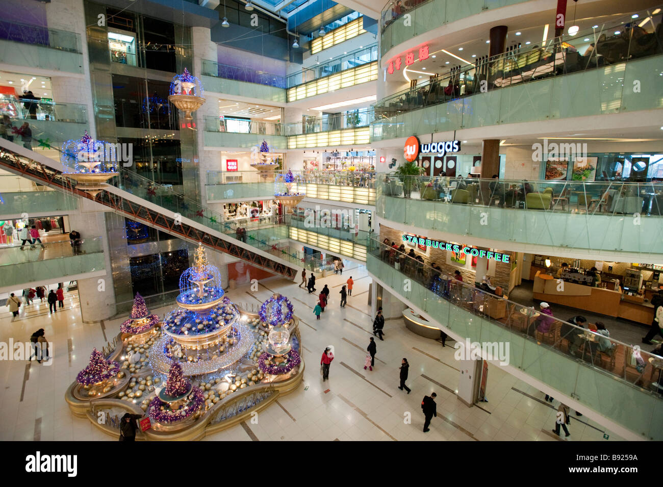 Interior of modern new Joy City shopping mall in Xidan district of Beijing China - Stock Image