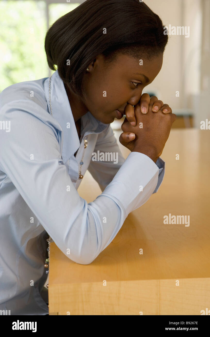 Businesswoman with hands clasped in desperation Cape Town Western Cape Province South Africa - Stock Image