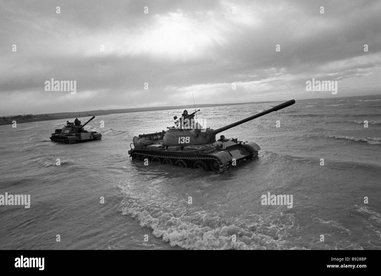 Tanks on the oceanic coast - Stock Image