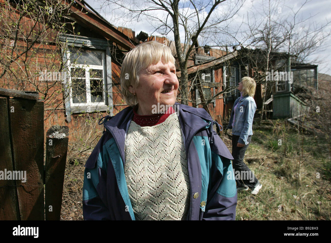 Valentina Kolyada in the foreground and Larisa Prikhodko lived in the village of Orevichi Belarus which was evacuated - Stock Image