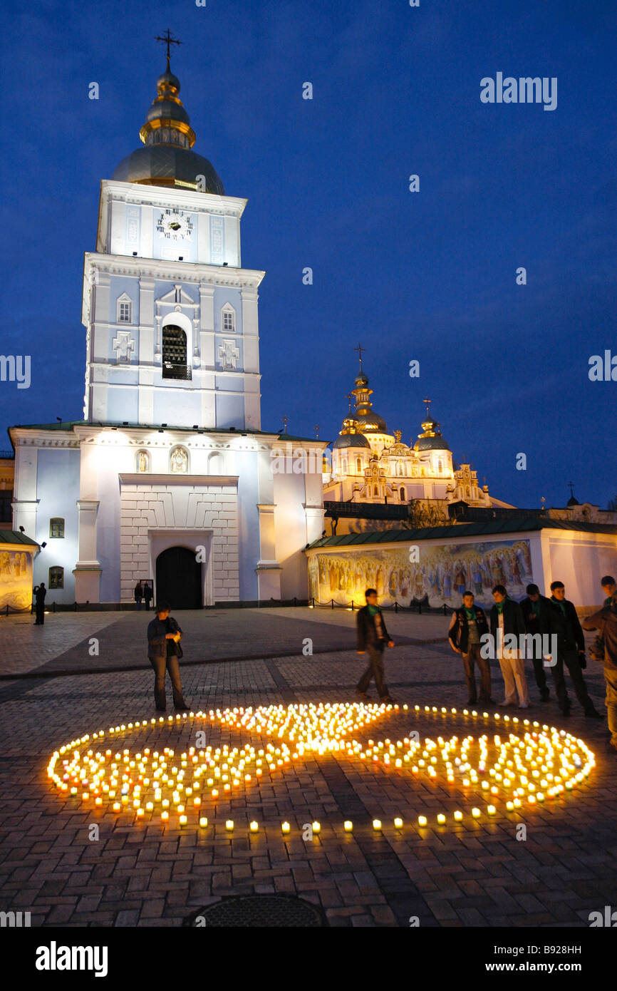 Activists of the Ukrainian Greens Party used candles to make a radiation sign in memory of the 21st anniversary - Stock Image