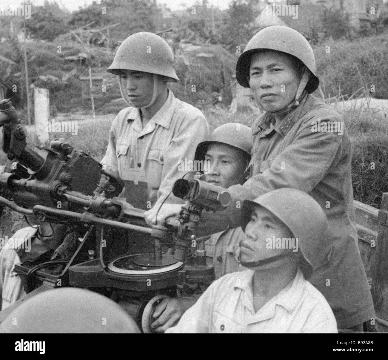 Vietnamese AA anti aircraft gunners ready to rebuff an air strike Stock Photo