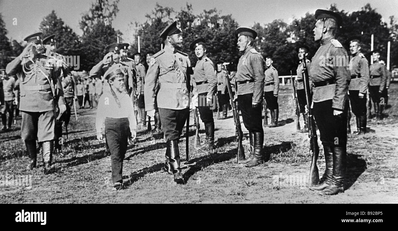Tsar Nicholas II center accompanied by his son Alexei second from left inspecting troops A reproduction of a photo - Stock Image