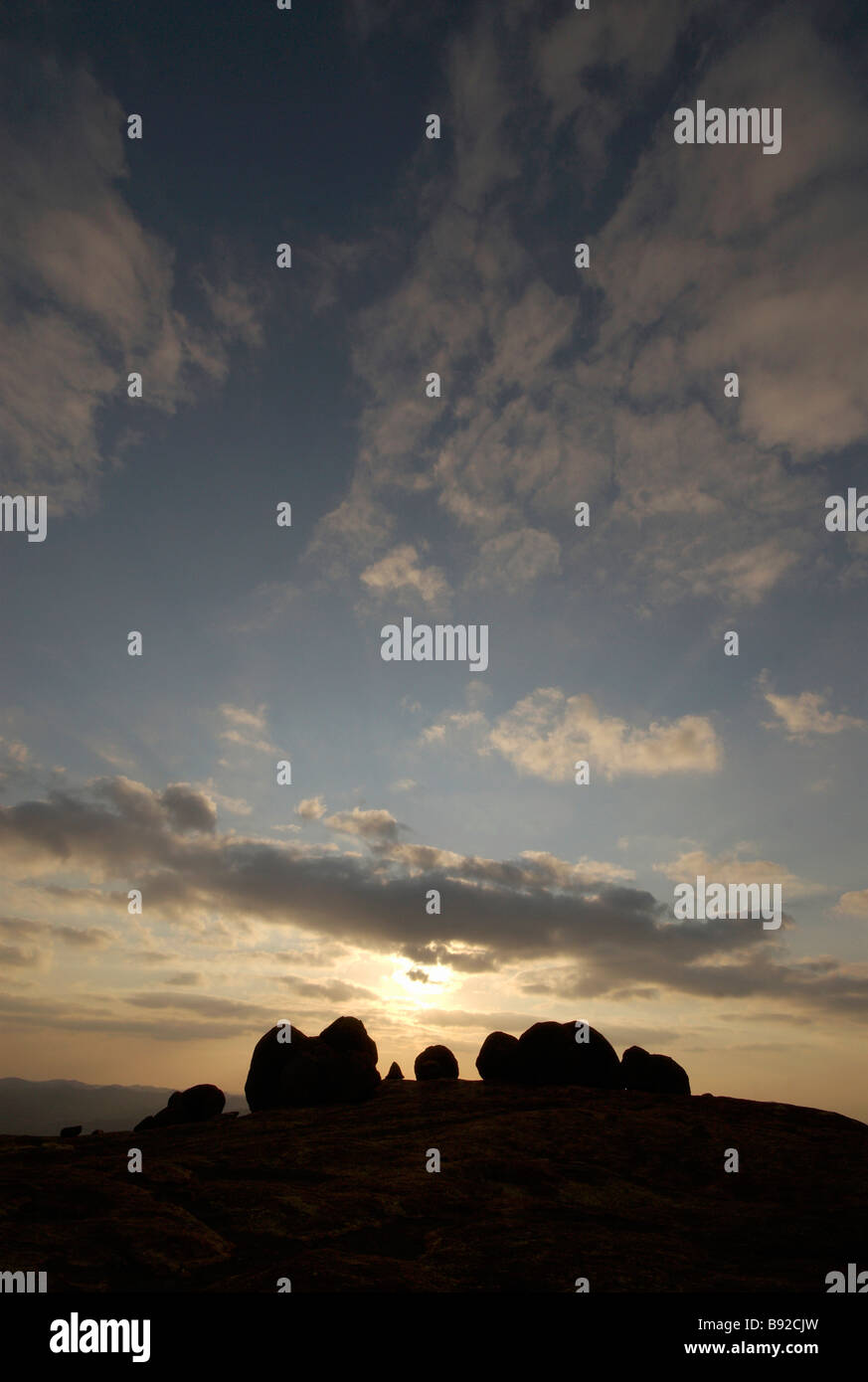 The sun sets behind Cecil John Rhodes' gravesite in the Matopos hills, Rhodes Matopos National Park, near Bulawayo, - Stock Image