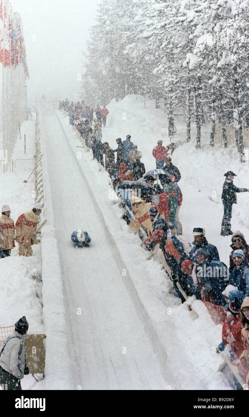 Bobsled race during Fourteenth Winter Olympics - Stock Image
