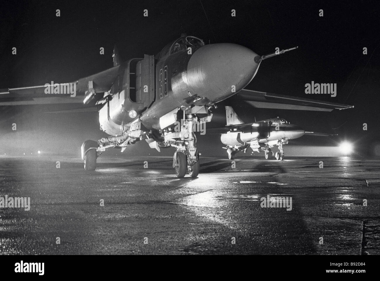 An echelon of MiG 23 Flogger fighters gearing up for a night training flight - Stock Image