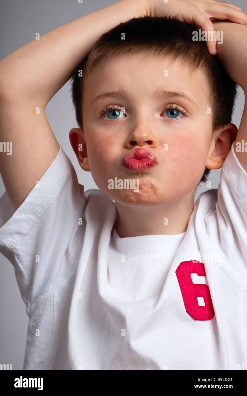 Little boy mimicking a monkey Stock Photo