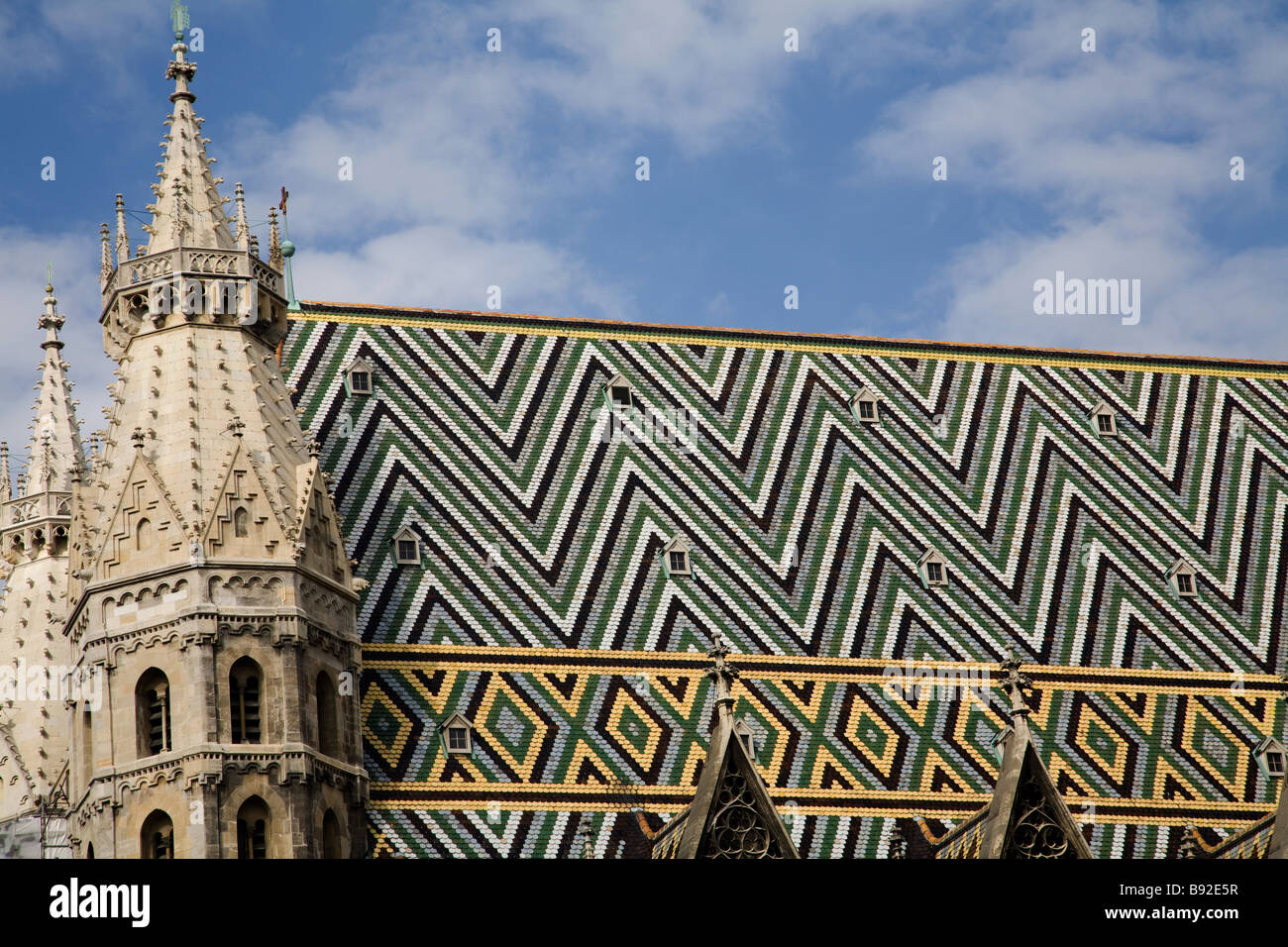 The multi coloured geometric roof of St Stephens Cathedral Stephansdom in the centre of Vienna Austria - Stock Image