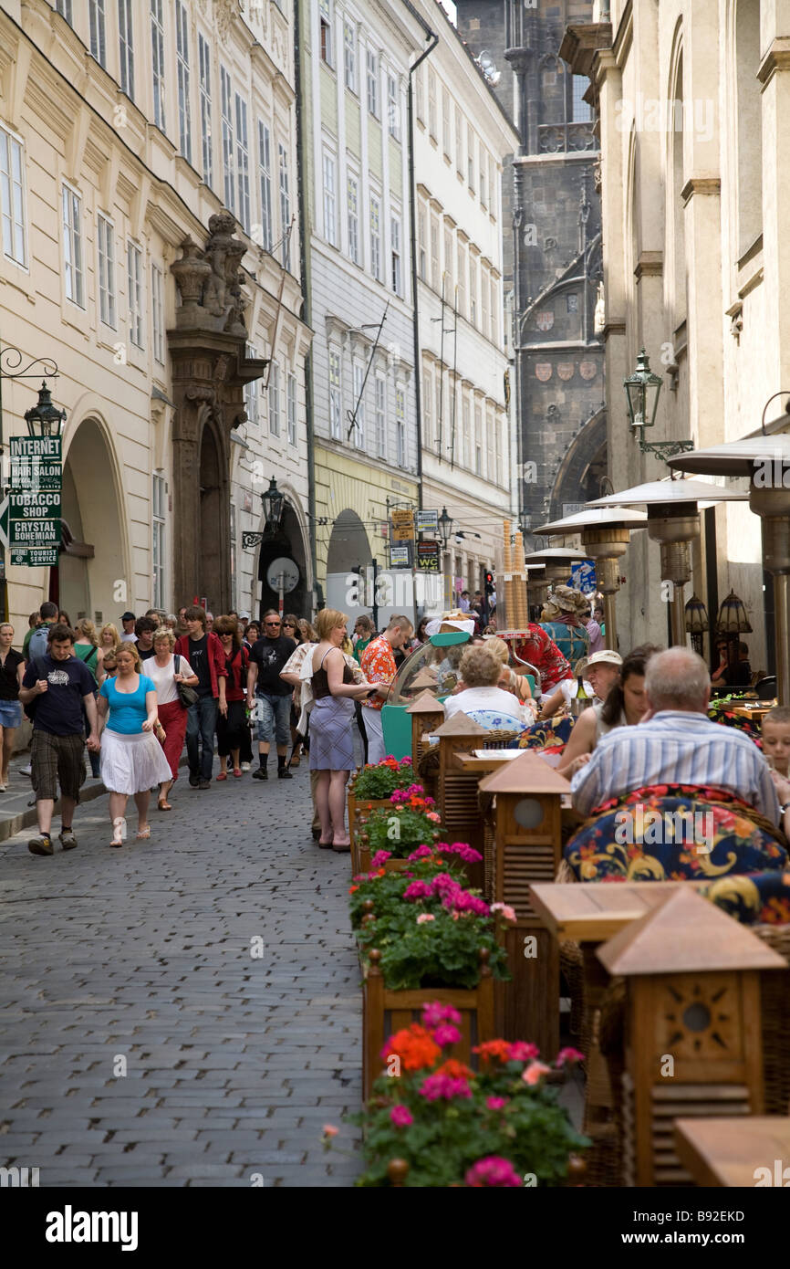 Sidewalk cafe along a cobbled street in Prague Czech Republic - Stock Image