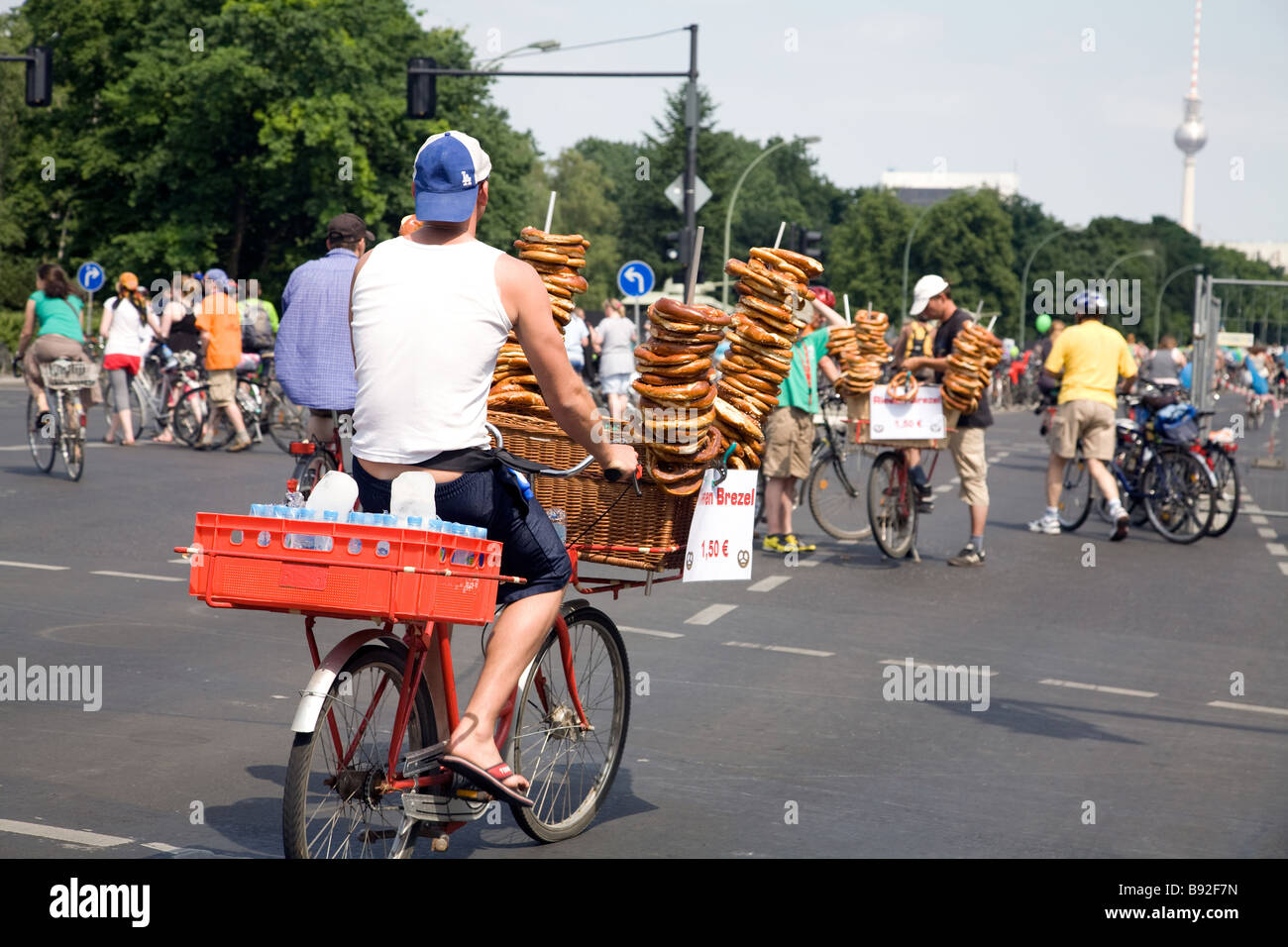Street vendors selling bread snacks and water to cyclists in Berlin Germany - Stock Image