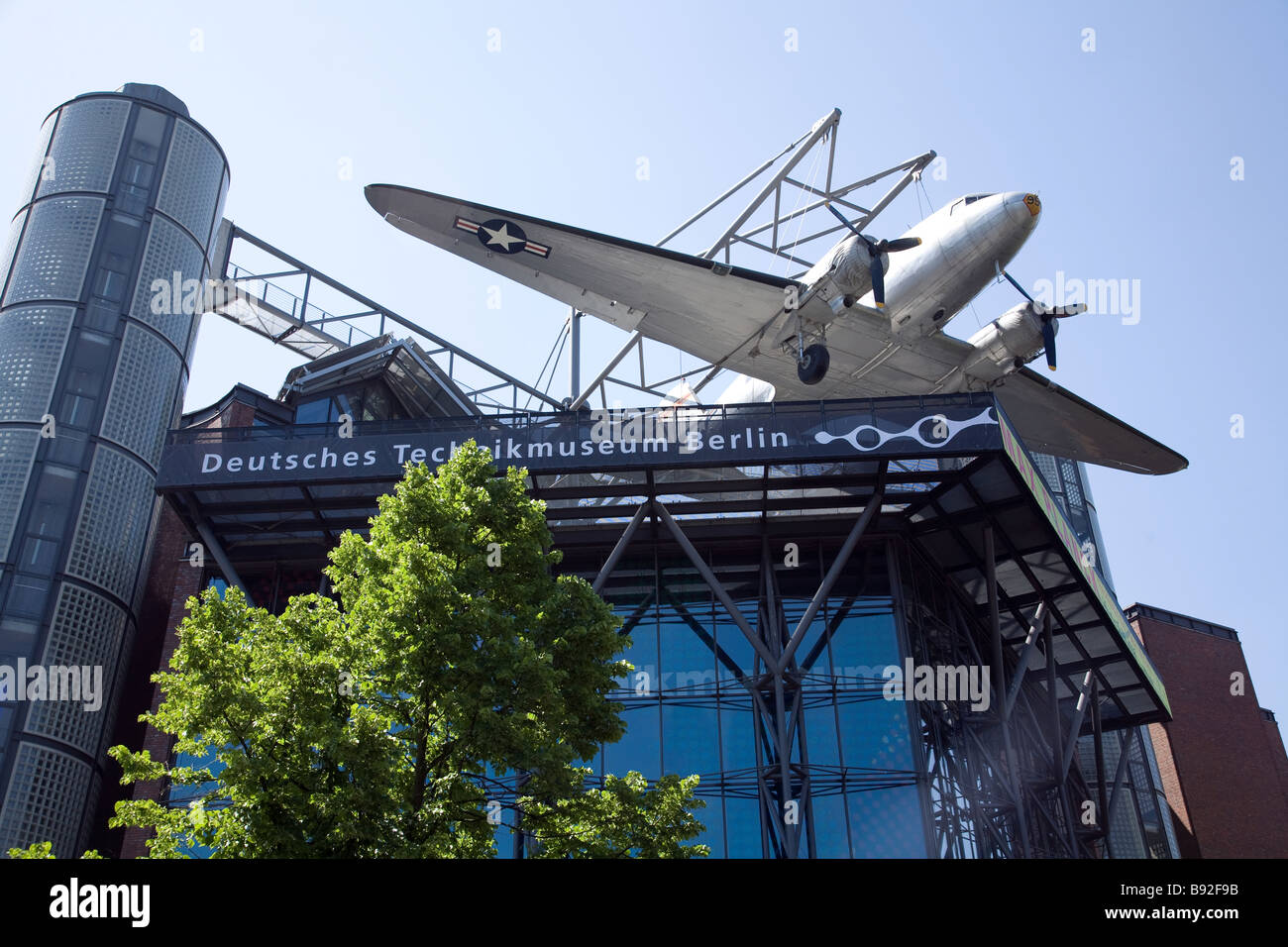 A Douglas C 47 sits on the roof of the Deutsches Technikmuseum in Berlin Germany - Stock Image