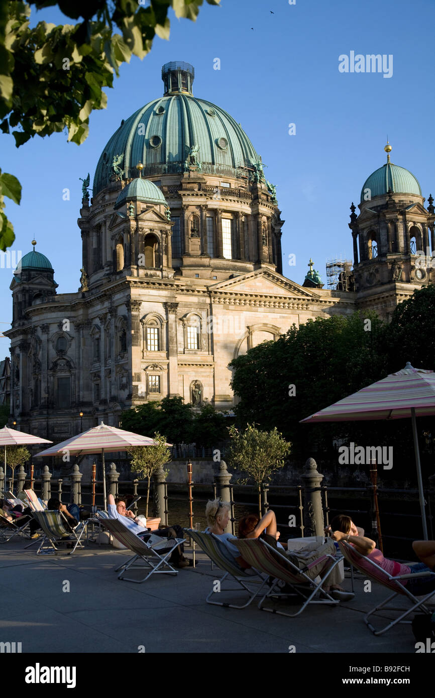 People relaxing by the Berlin Cathedral Berliner Dom Berlin Germany - Stock Image