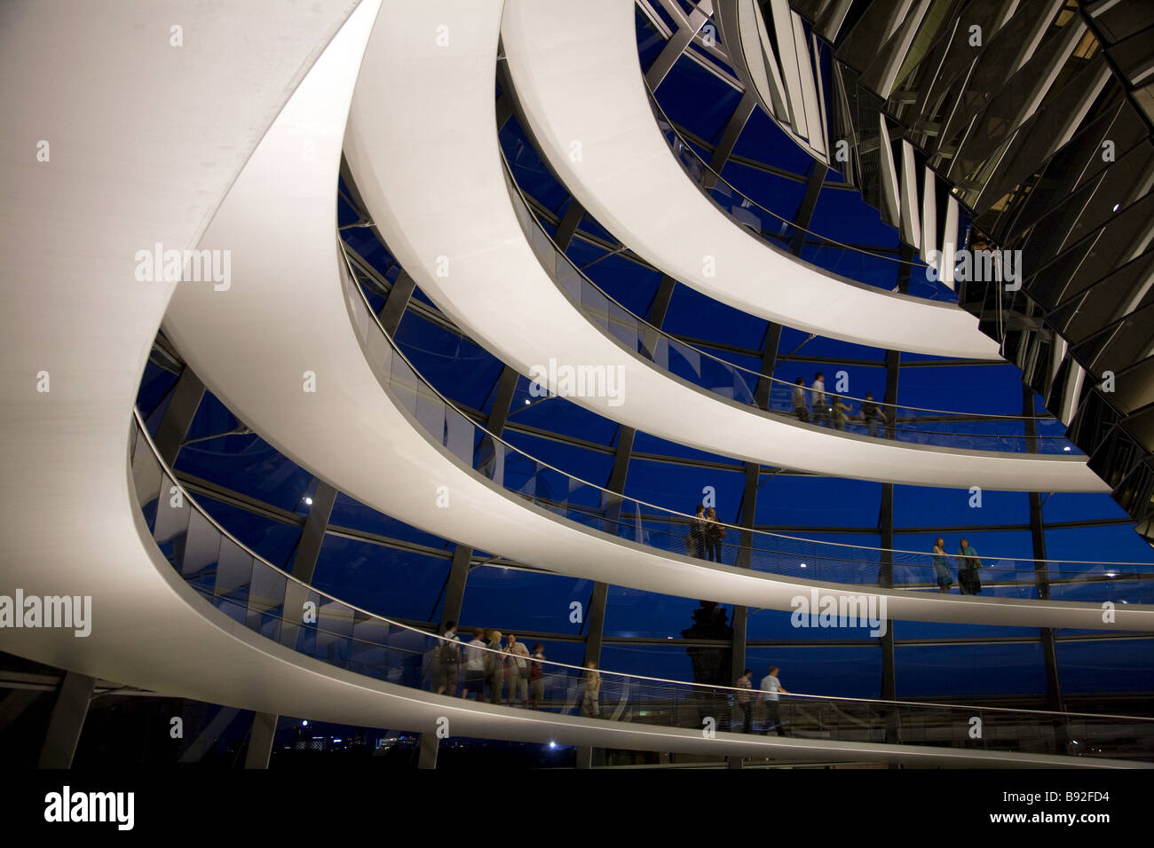 The glass dome atop the Reichstag where visitors can observe the Bundestag the lower house of the German parliament - Stock Image