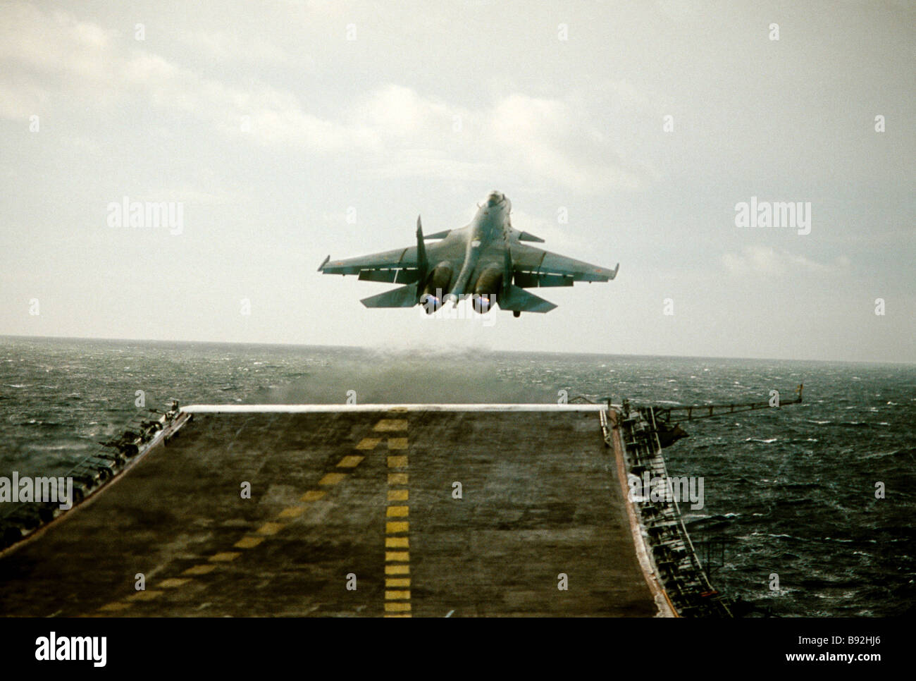 Sukhoi Su 27 K Flanker supersonic deck fighter takes off from aircraft carrier Admiral Kuznetsov Russian Navy s - Stock Image
