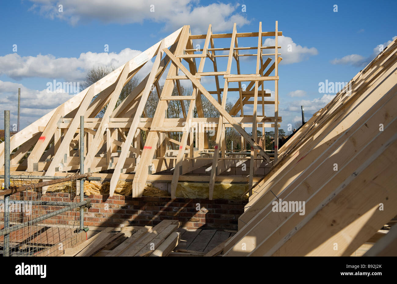 The Hip End now joined to attic trusses in the course of building the roof structure. - Stock Image