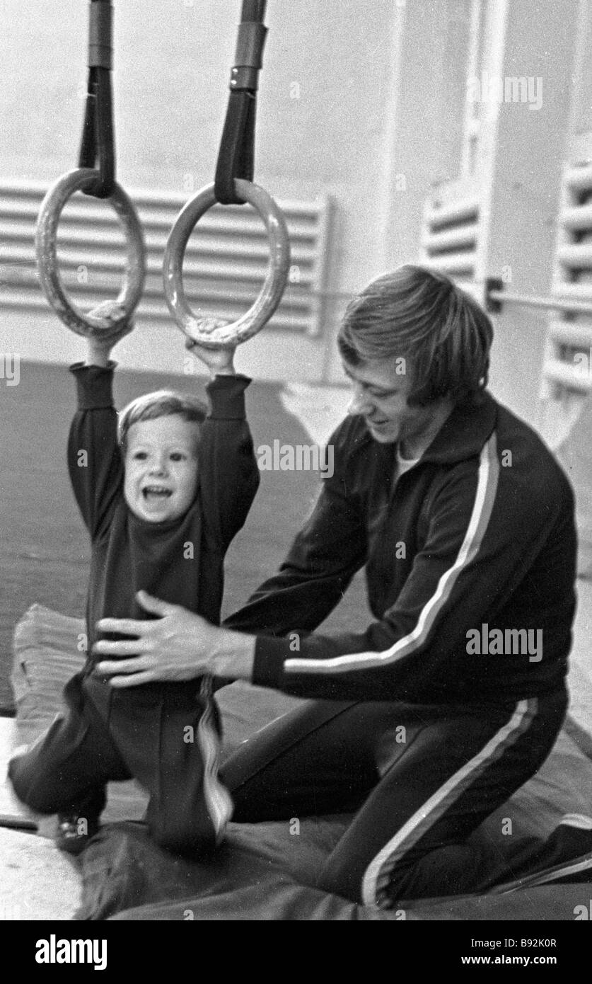 21st Olympics Champion Merited master of sports of the USSR Nikolai Andrianov and his son Sergei also a sportsman - Stock Image