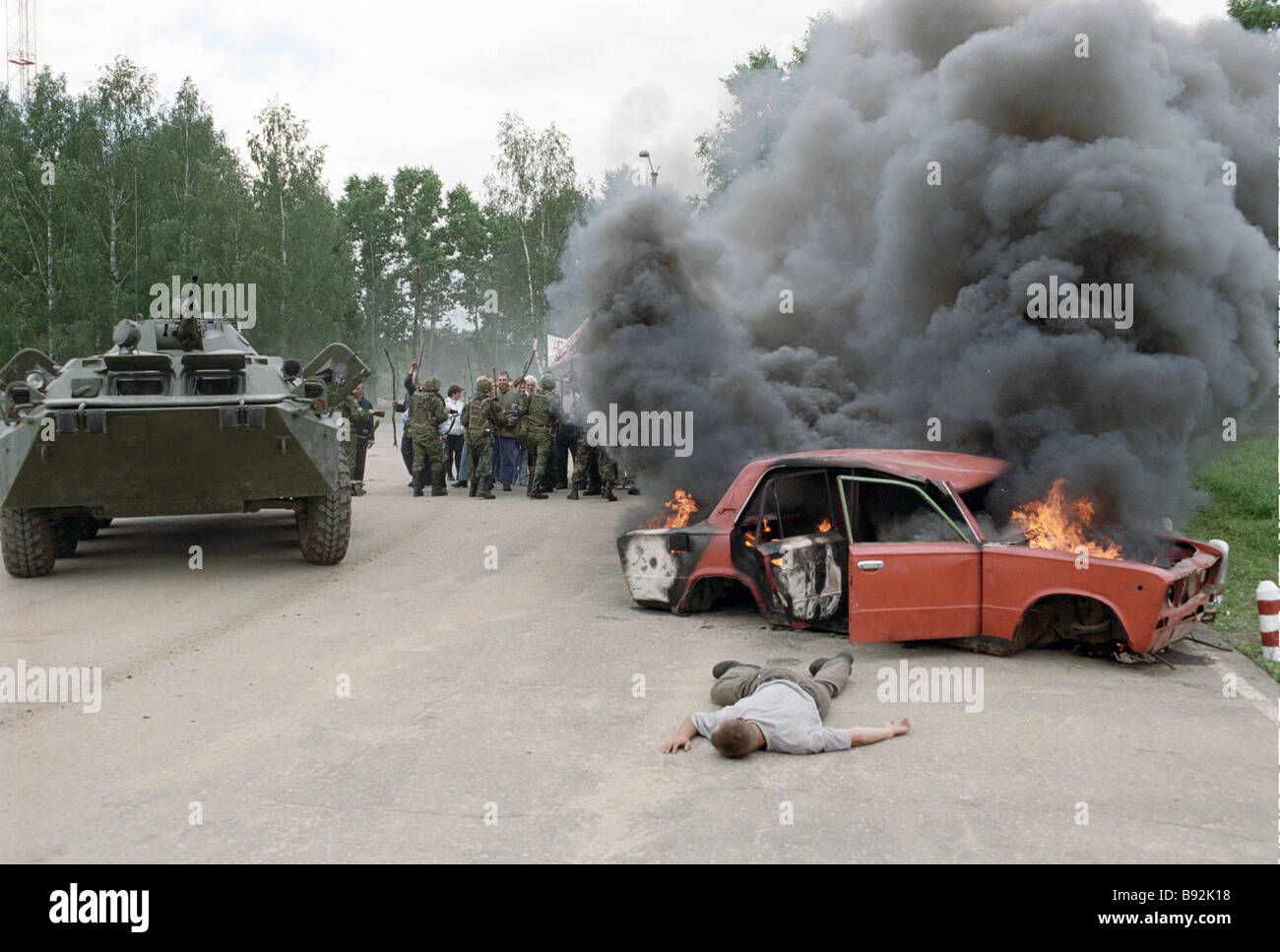Russian Army troops eliminate a mock up conflict among the locals peacekeeping exercise - Stock Image