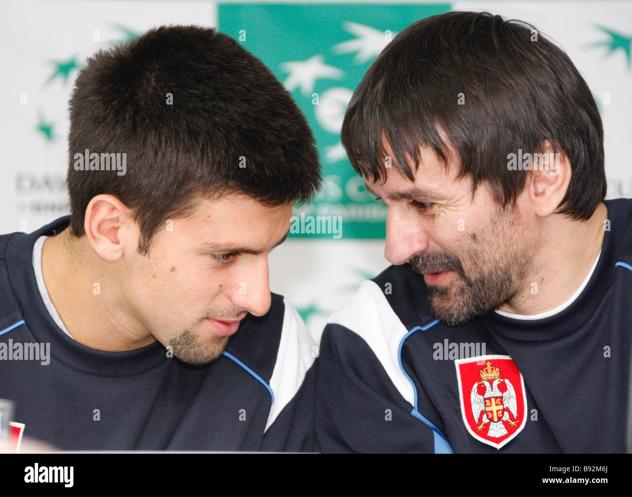 Serbian tennis player Novak Djokovic and captain of the Serbian team Bogdan Obradovic left to right at a press conference - Stock Image