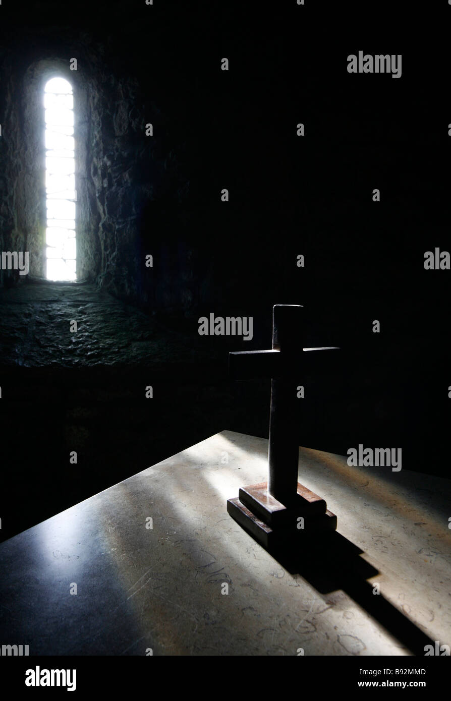 Simple Wooden Cross on an Alter in a Chapel - Stock Image