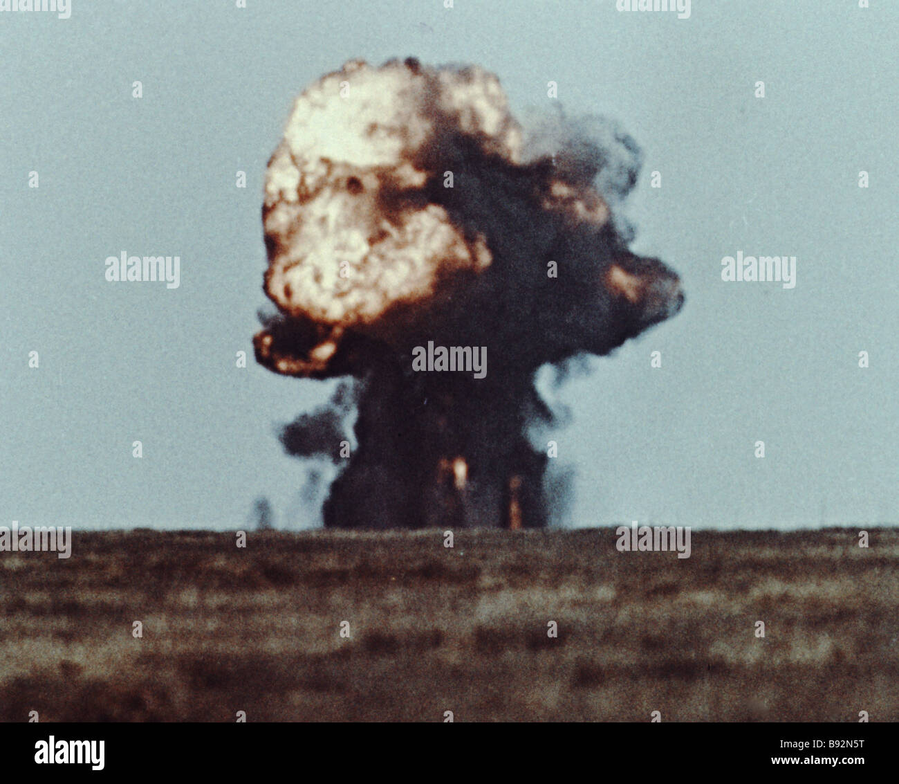 A nuclear mushroom cloud A scene from the film I serve the Soviet Union - Stock Image