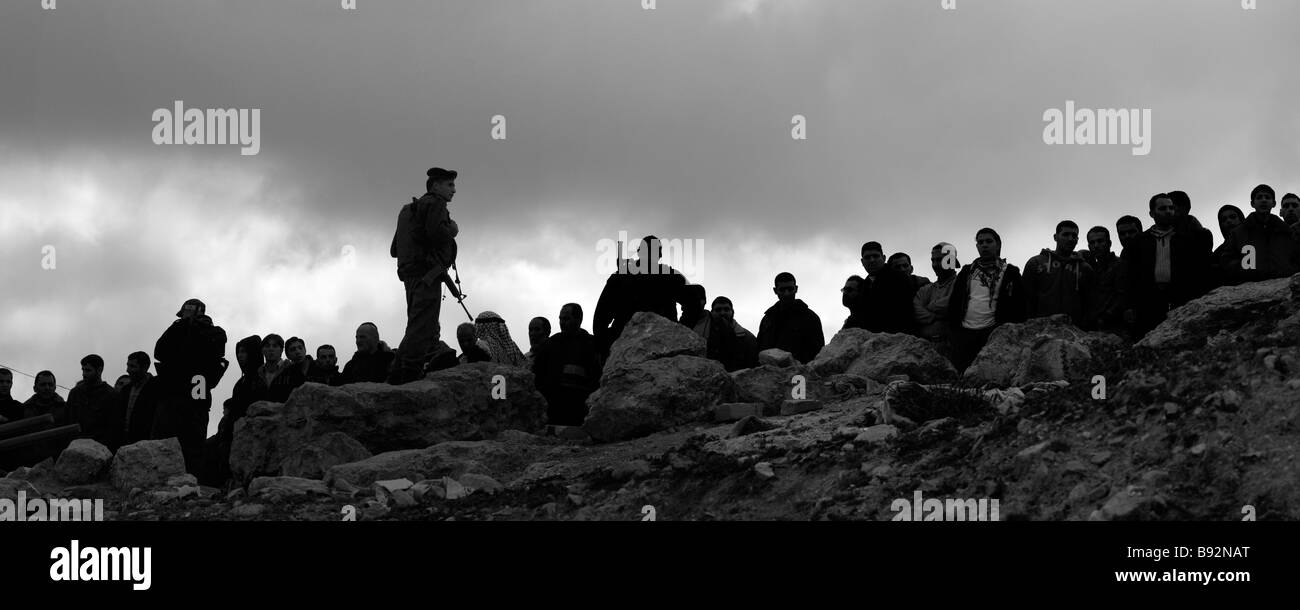 Israeli soldiers blocking passage to Palestinian villagers in the West Bank Israel Stock Photo