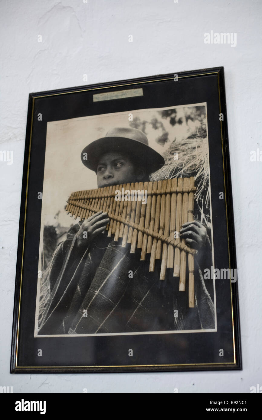 Old photograph of Quichua boy playing the rondador, Northern Highlands, Ecuador - Stock Image