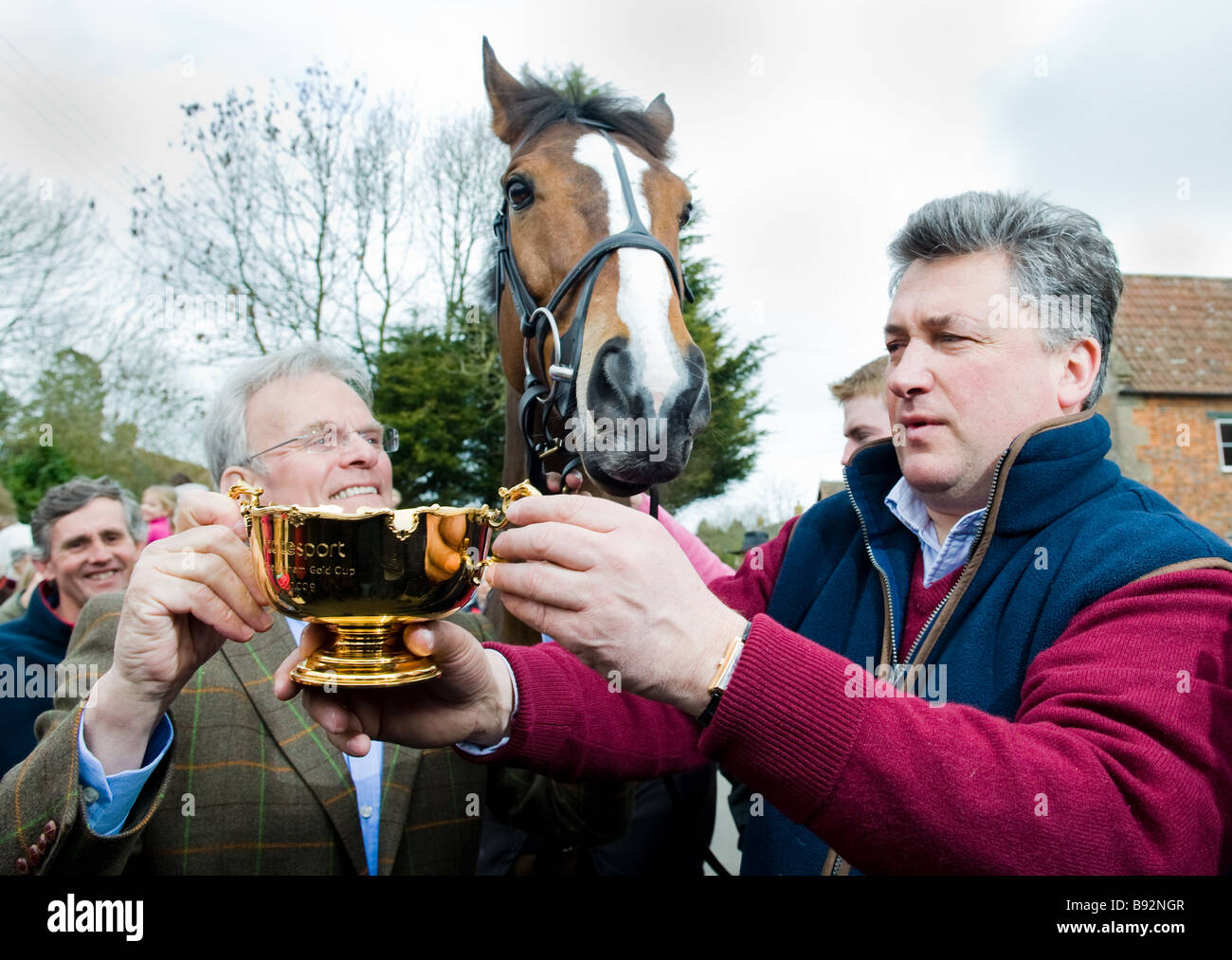 'Kauto Star' with owner Clive Smith (left) and trainer Paul Nicholls (right) with the Chetenham Gold Cup, - Stock Image