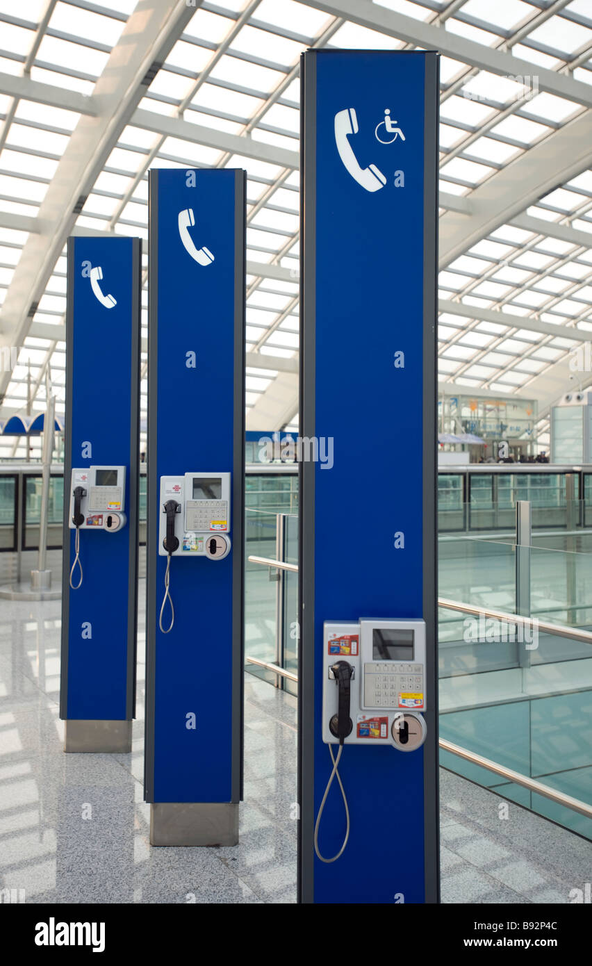Modern public telephones at new Terminal 3 at Beijing Airport - Stock Image