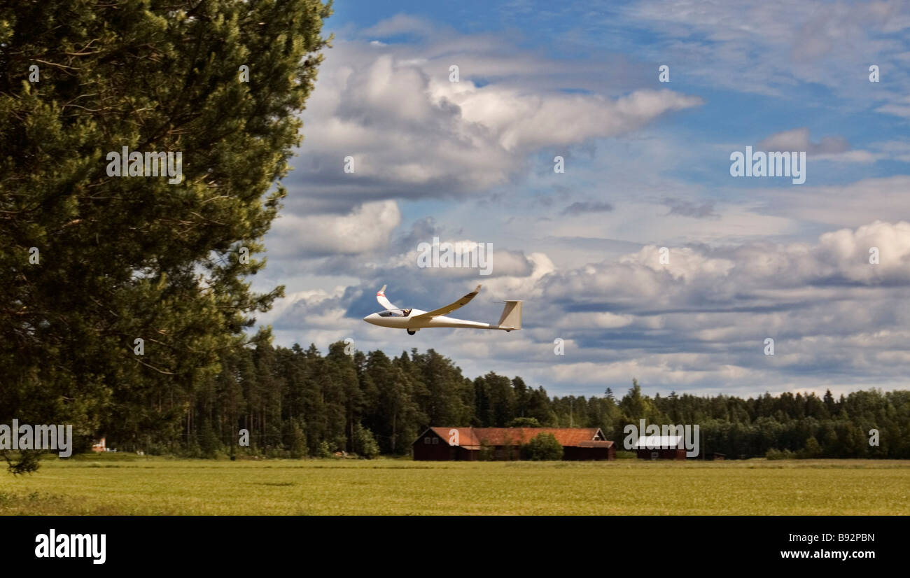 Small aircraft flying low in Sweden, Dalarna - Stock Image