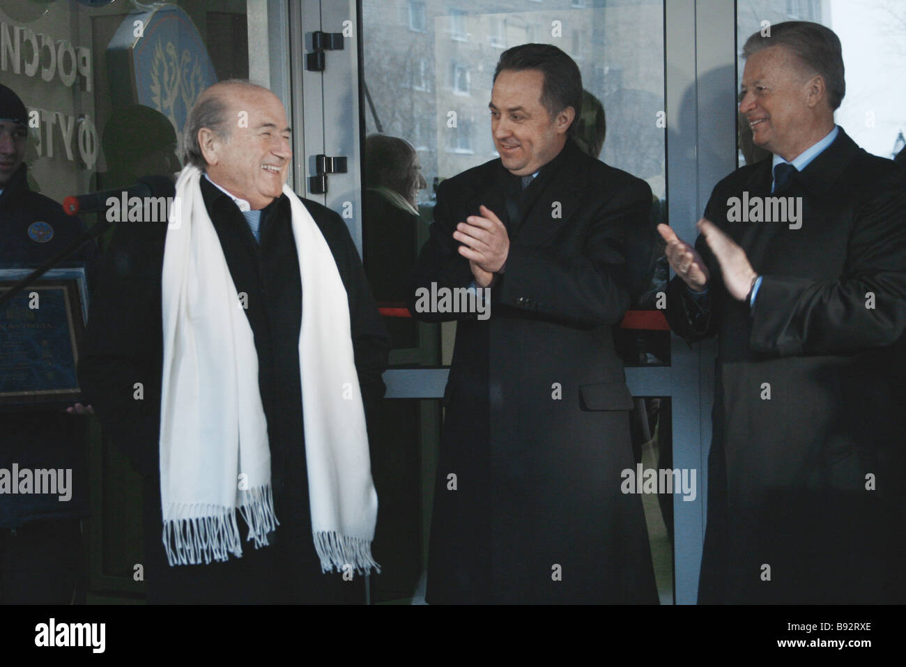 Left to right FIFA President Joseph S Blatter Russian Soccer Union President Vitaly Mutko and Russian Olympic Committee - Stock Image