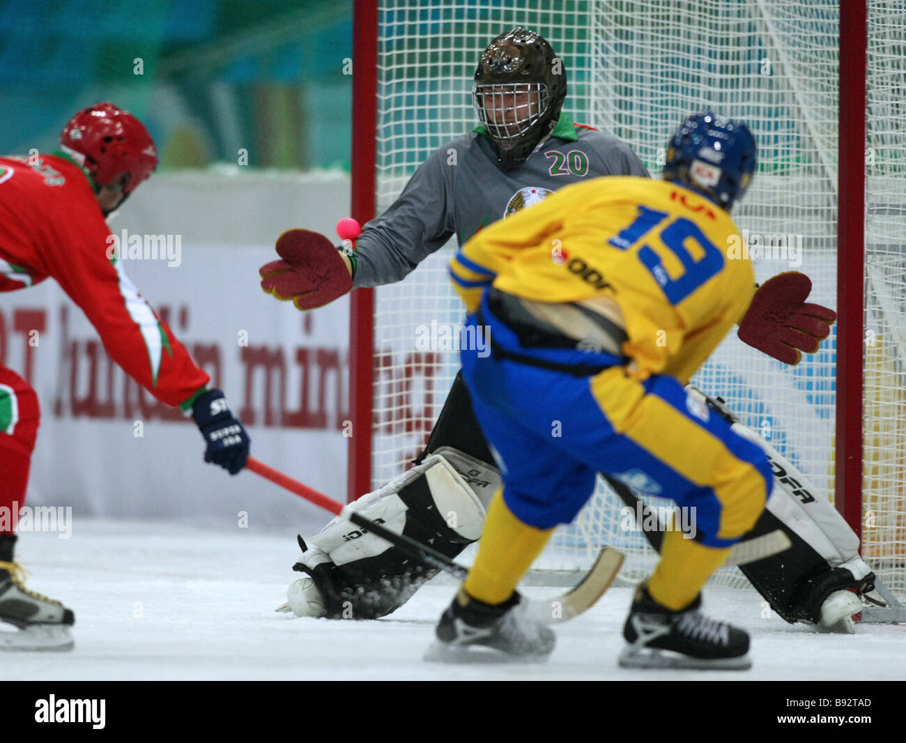 Goalie Dmitry Poshelyuk of the Belarusian team tries to beat off a Swedish attack during the Group A match of the - Stock Image