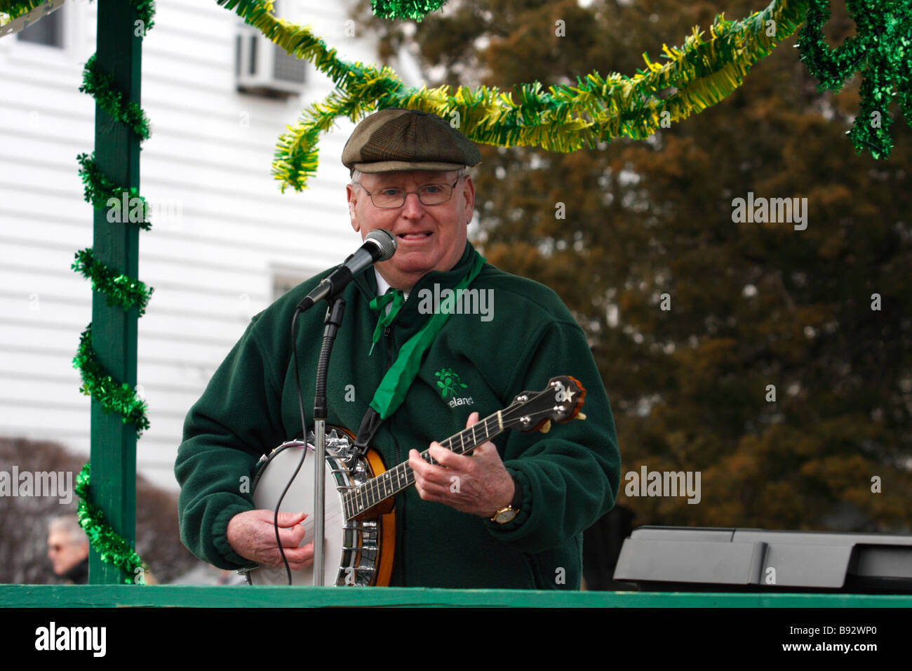 Man playing Banjo on float in St Patricks Day Parade - Stock Image