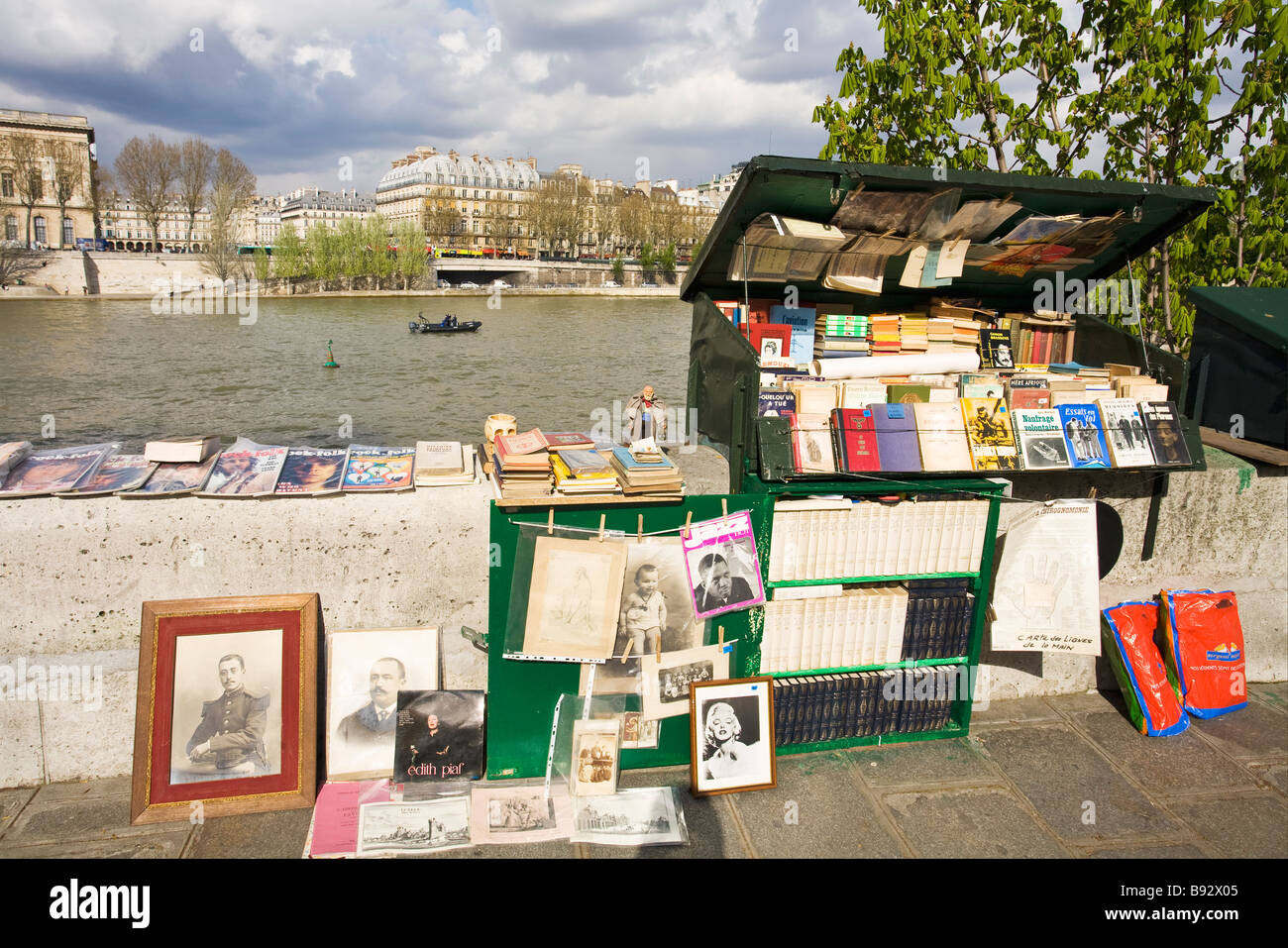 Secondhand book store on quay River Seine Paris France Europe - Stock Image