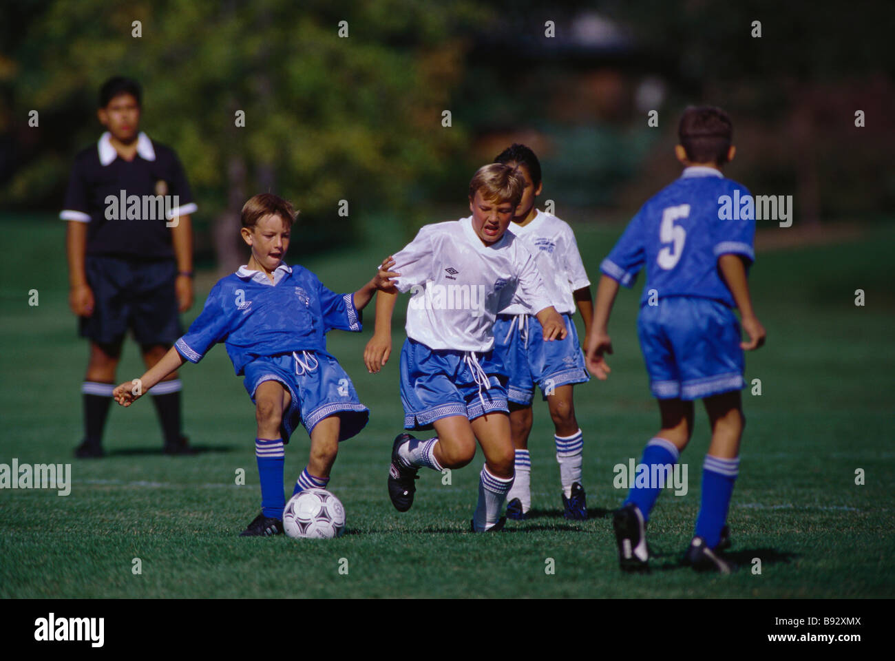 11 year old boys soccer action Stock Photo: 22807146 - Alamy