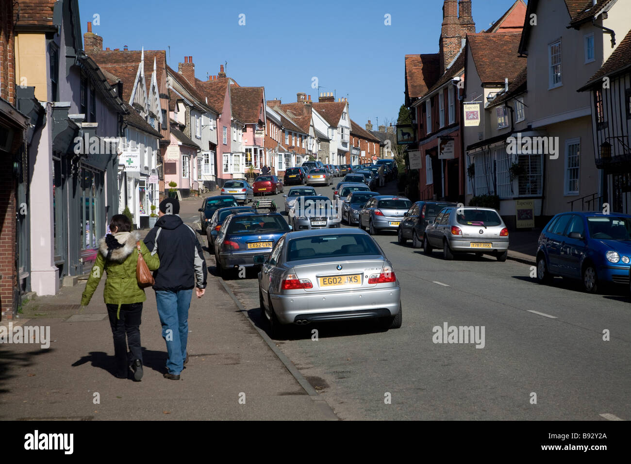 Cars and people street Lavenham Suffolk England - Stock Image