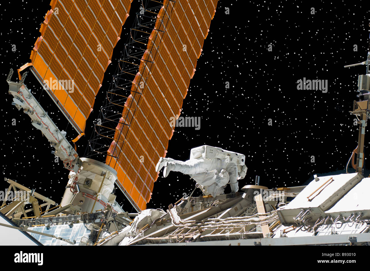 NASA astronaut working on solar panels for International Space Station - Stock Image
