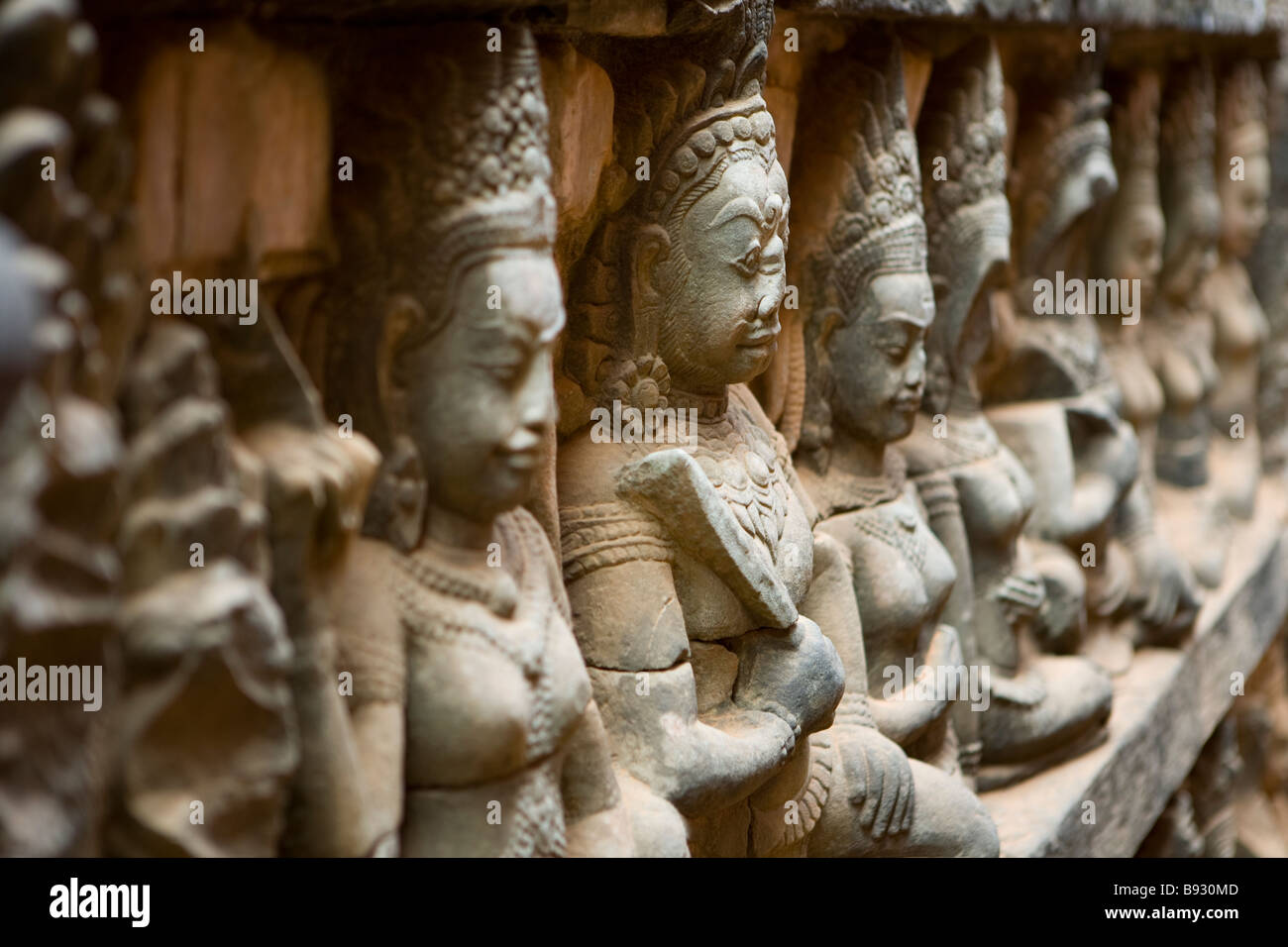 Sculptures on the walls photographed at the Terrace of the Leper King Angkor Wat City Cambodia - Stock Image