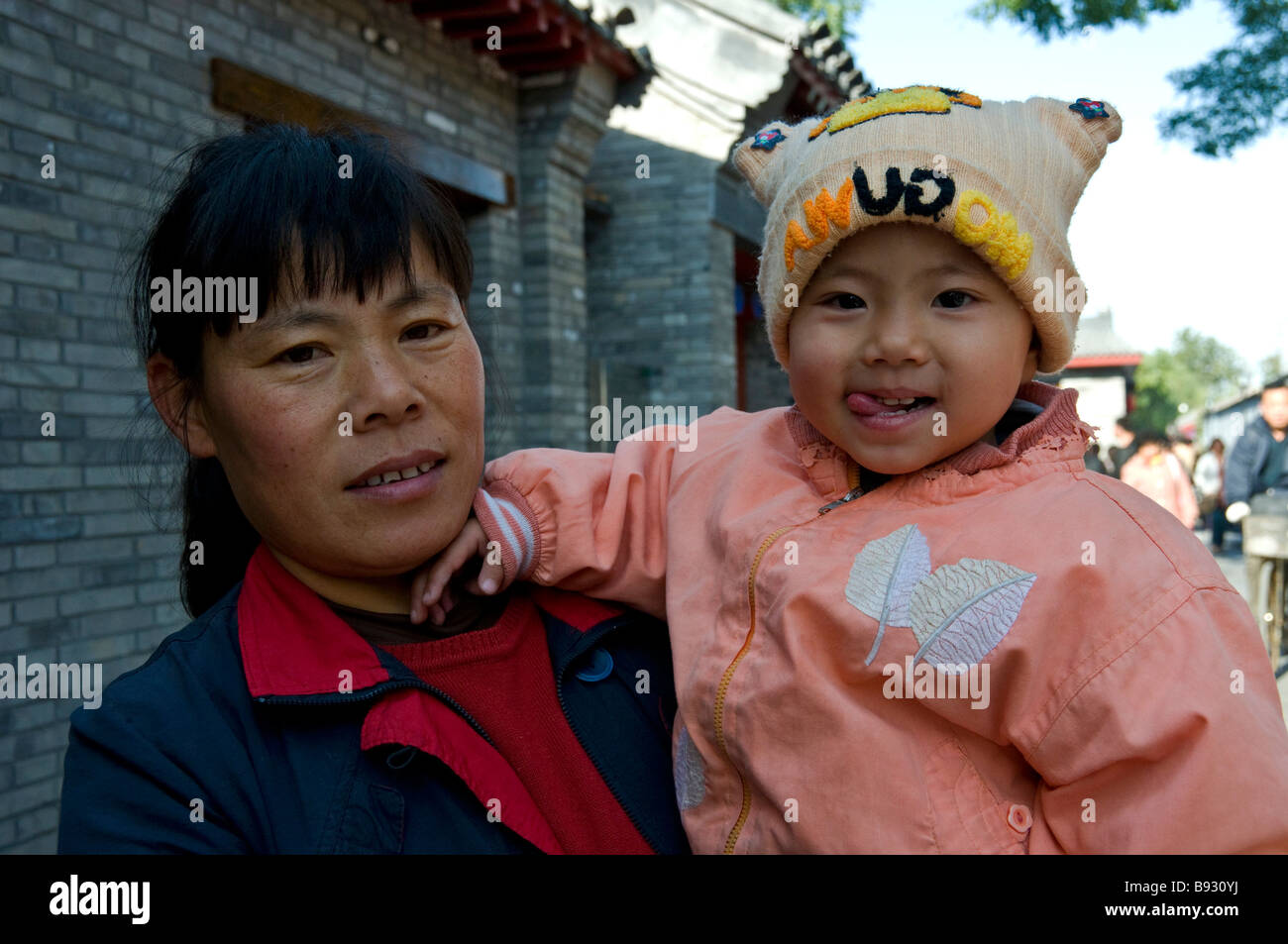Mother and baby Beijing China - Stock Image