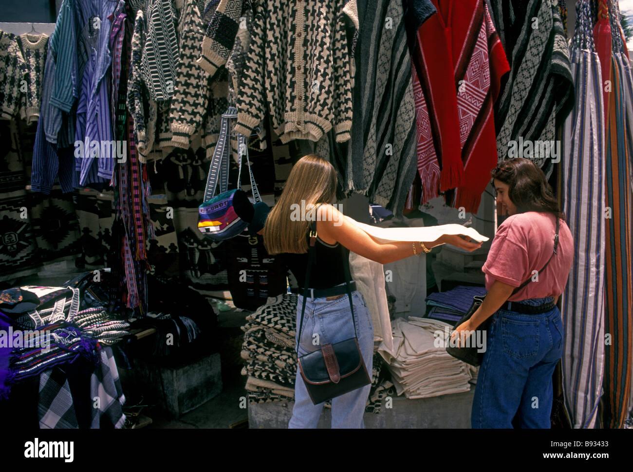 Ecuadoran women, vendor, shopping, Otavalo Market, Indian market, Plaza de Ponchos, town of Otavalo, Imbabura Province, - Stock Image