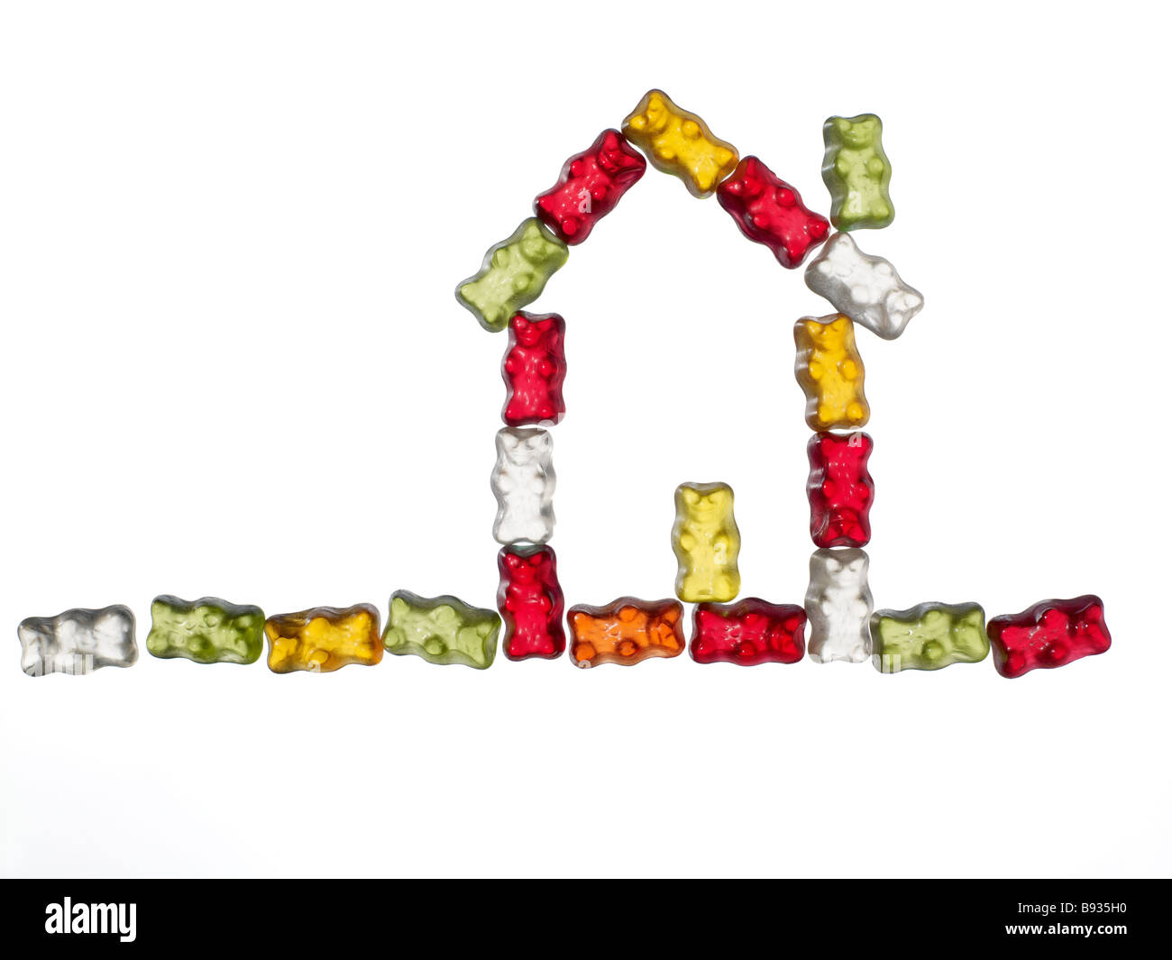 jellybabies formed as a house on white background - Stock Image