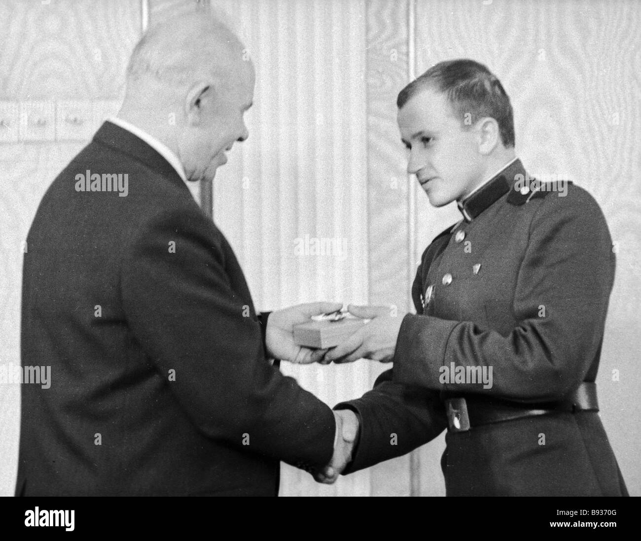 The Presidium Chairman of the USSR Supreme Soviet Nikolai Podgorny left presents the Order of the Red Banner to - Stock Image