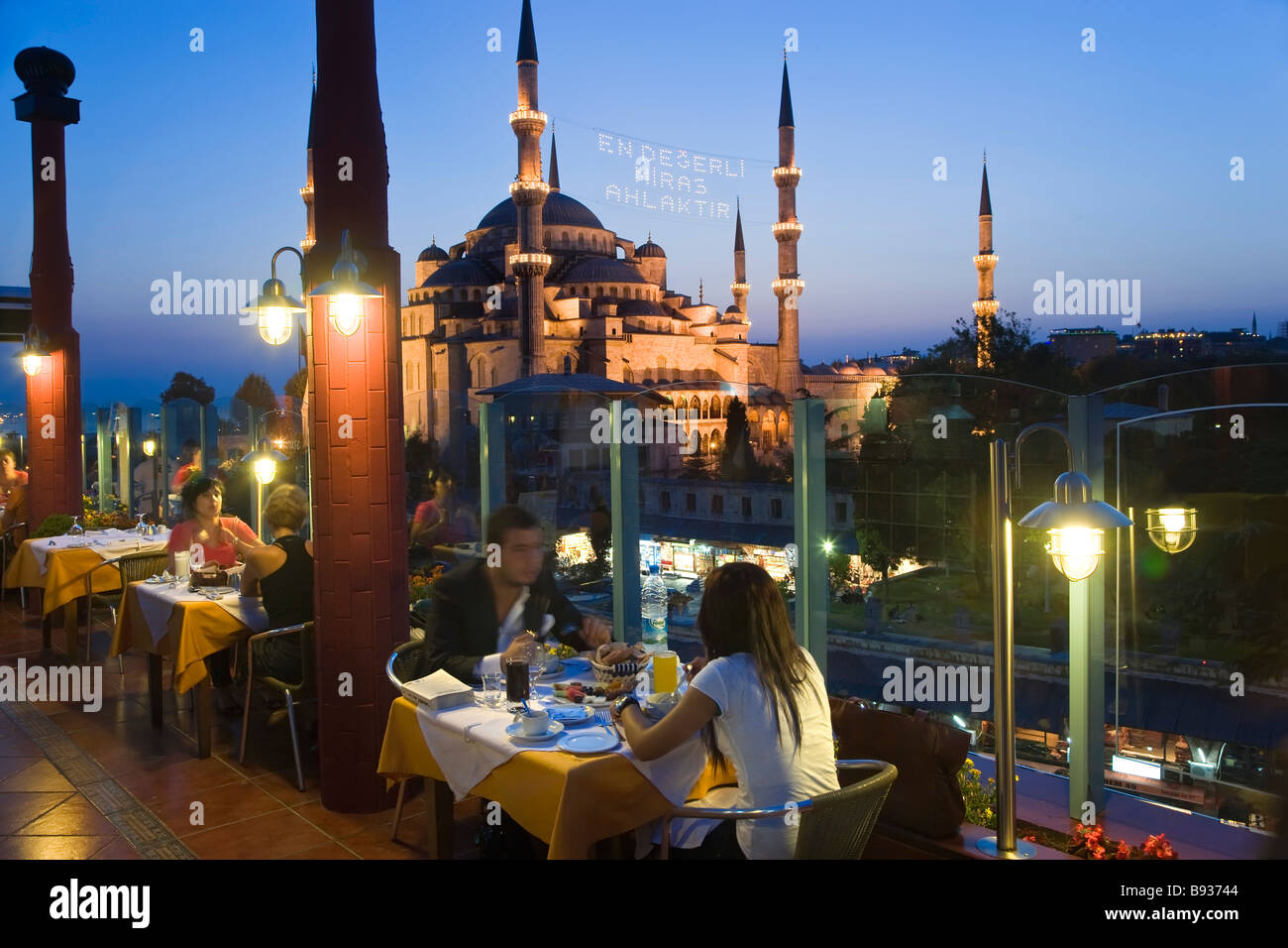 The Blue Mosque or Sultan Ahmet Mosque 1609 1616 rooftop restaurant dusk Sultanahmet District Istanbul Turkey - Stock Image
