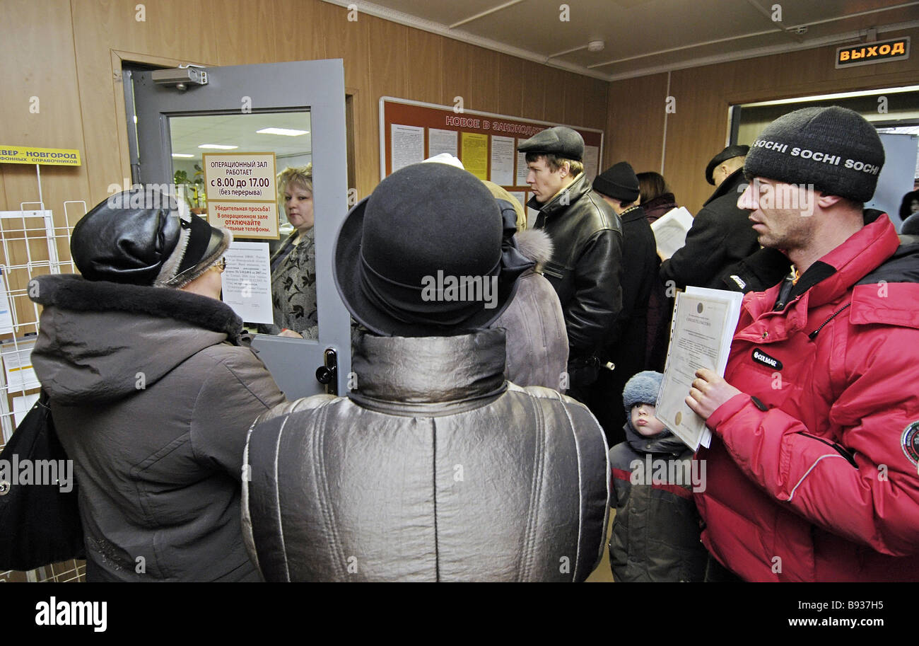 People waiting to submit their income tax returns to department 9 of the tax inspectorate of the Novgorod region - Stock Image