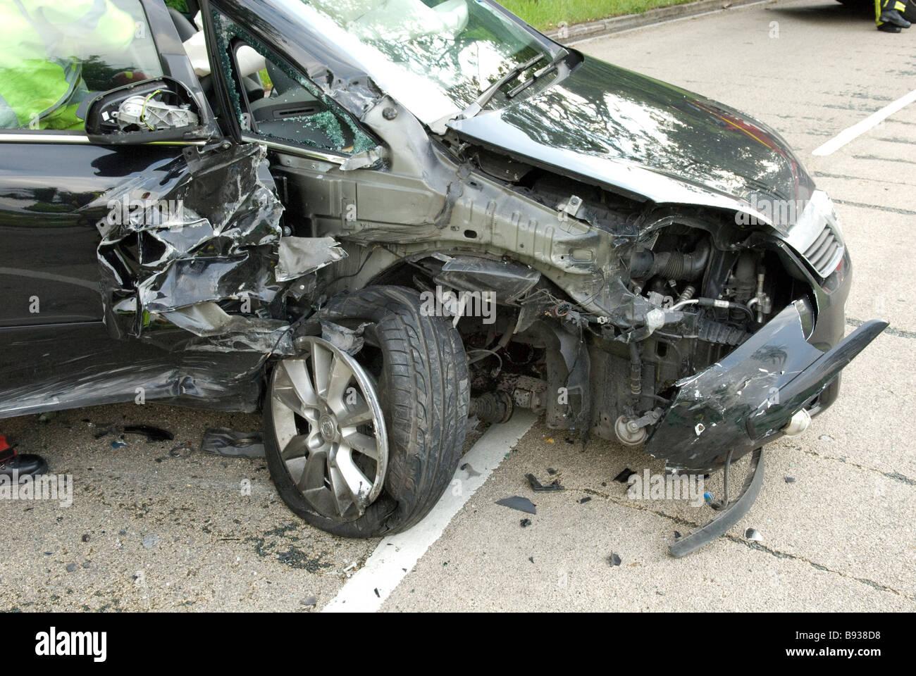 Crashed car with badly damaged wing RTC Stock Photo
