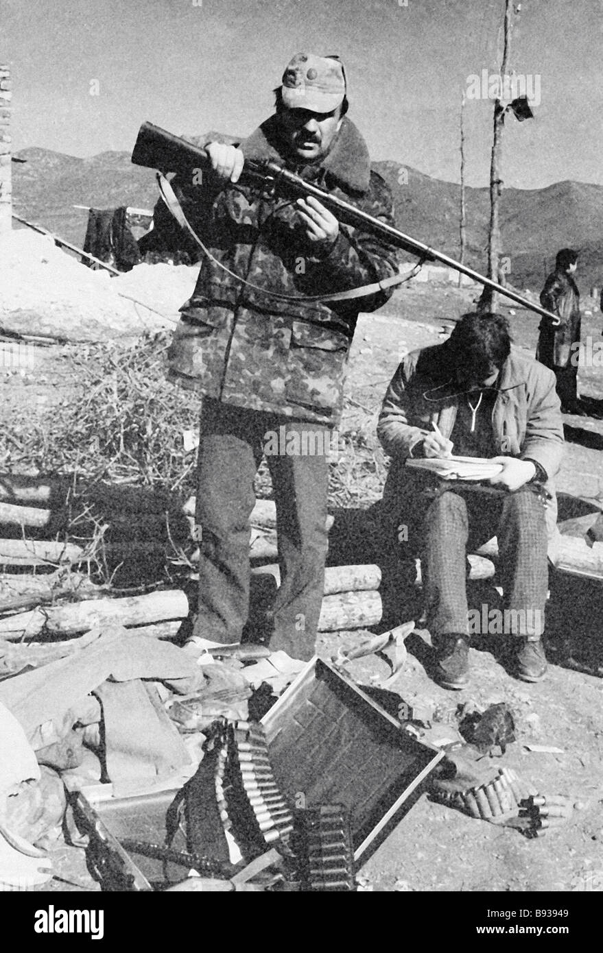 Servicemen listing the arms confiscated from the Spitakshen village detainees during the Armenian Azeri conflict - Stock Image
