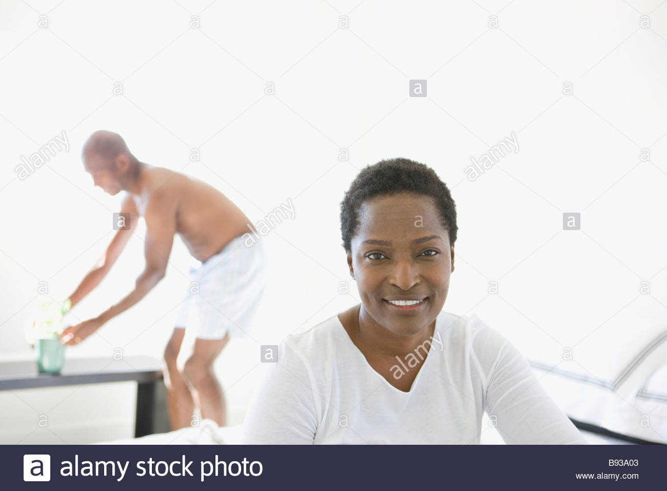 Portrait of woman at home with husband Stock Photo